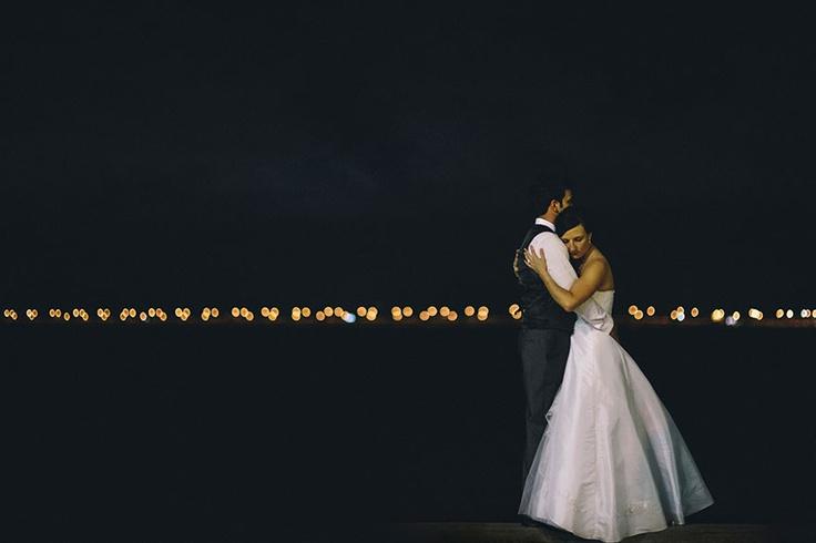 Bride and groom at night with city bridge lights behind them by www.richardgrainger.com.au