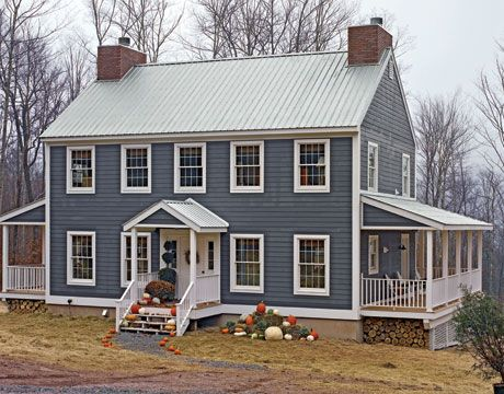 Perfect farmhouse.  I love the paint color, all the windows, the tin roof, and the porch.