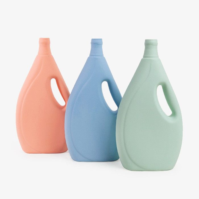 Dutch artist Foekje Fleur van Duin, plastic detergent bottles pulled from the canals in Rotterdam are commemorated in durable, natural colored porcelain. The outside of the stained porcelain is bisque which gives a matte finish similar to plastic. $48 each from Foekje Fleu. Remodelista