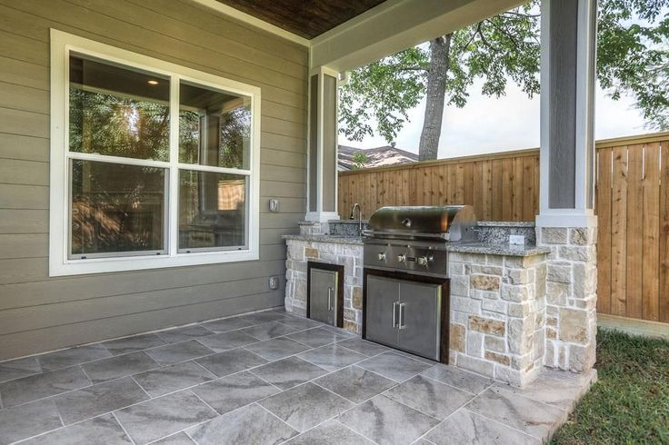 Outdoor kitchen has gas grill, wet sink, mini fridge and some storage space.