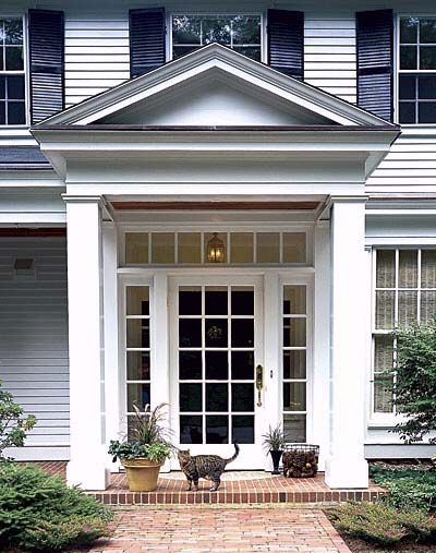 To emphasize the main entry, architect Ben Nutter gave it a portico with classical proportions: four beefed-up columns (patterned after the originals) topped with a gabled roof.