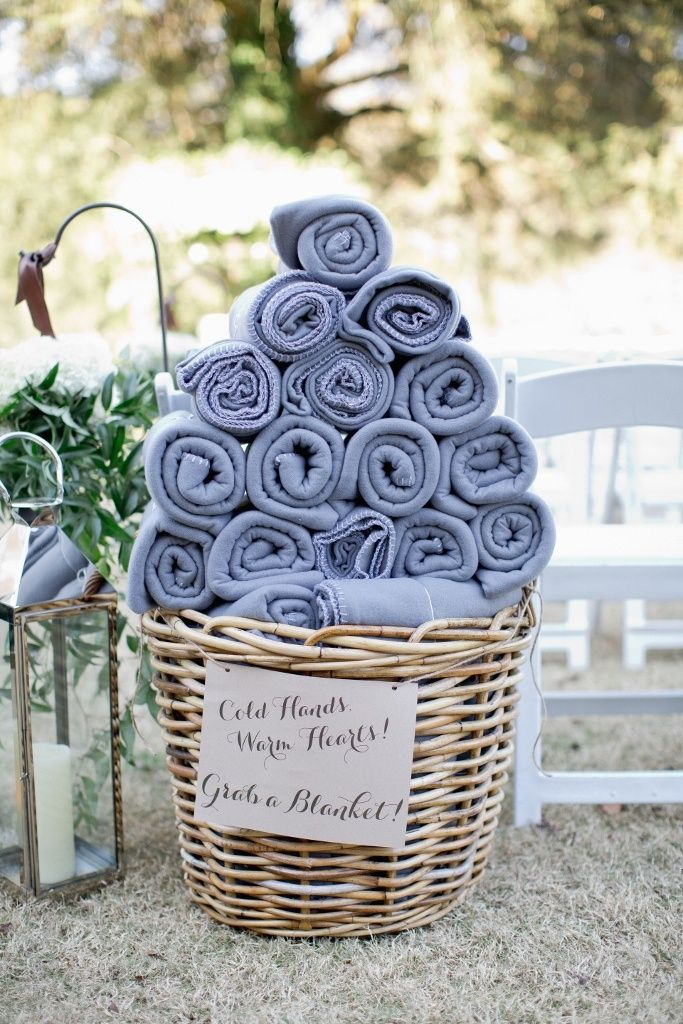 Outdoor wedding idea: for a cool spring or fall wedding, provide warm blankets or hand warmers for chilled guests.