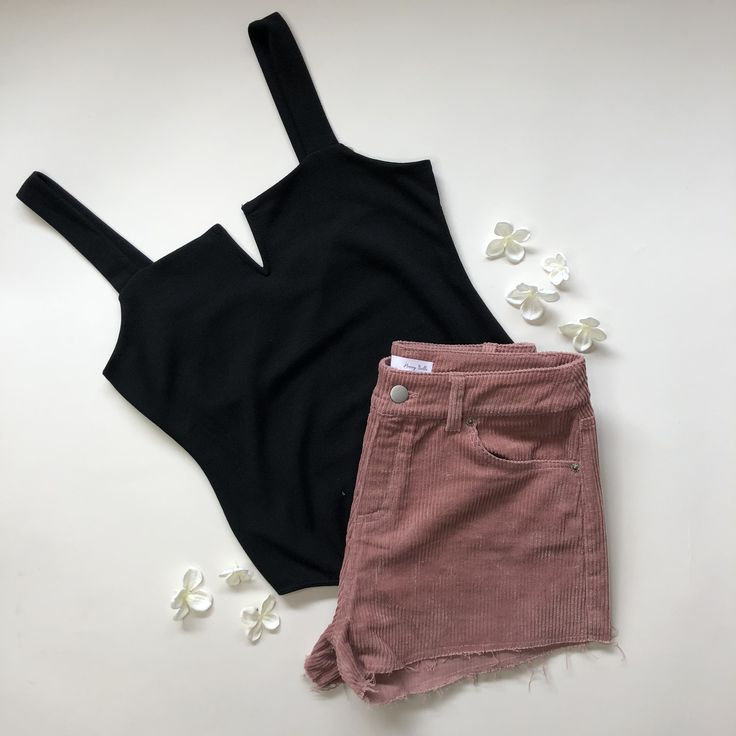 We are obsessing over these pink corduroy shorts paired with this black bodysuit! #fashion #style #outfits