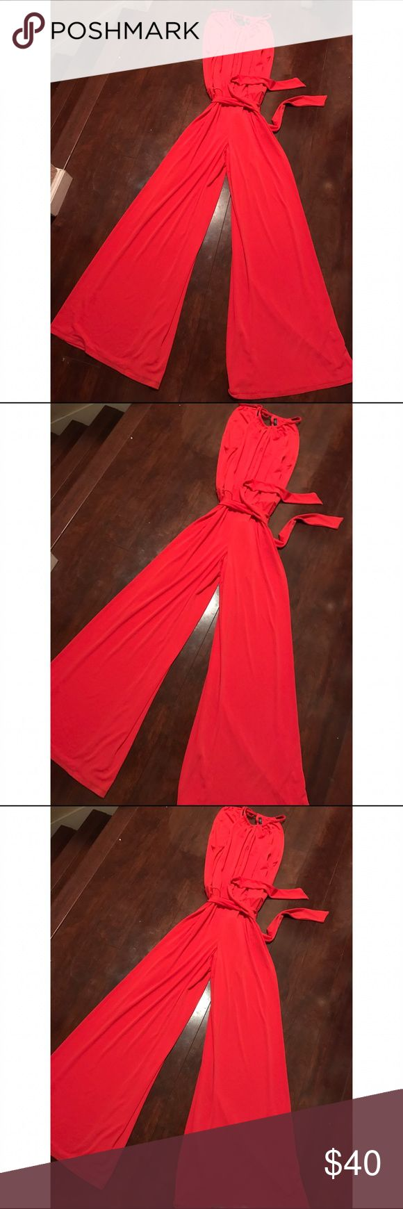 Ralph Lauren Coral JumpSuit💛💛 Gorgeous Coral JumpSuit By Ralph Lauren. Sleeveless with tie waist and wide legs for the Chic Fashionable Look!! NWT Size Large Ralph Lauren Pants Jumpsuits & Rompers