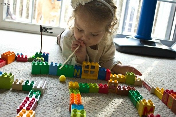 Building and Blowing!  Oral motor and fine motor game all rolled into one.  Visit pinterest.com/arktherapeutic for more #oralmotor #finemotor games