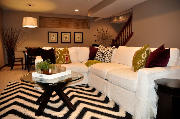 basements - Sherwin Williams - mega greige - nate rug, botanicals, ikat pillows, west elm mirror, overstock art, coffee table, glass top coffee table, chevron rug, slipcovered sectional, white slipcovered sectional, mega greige, basement family room,