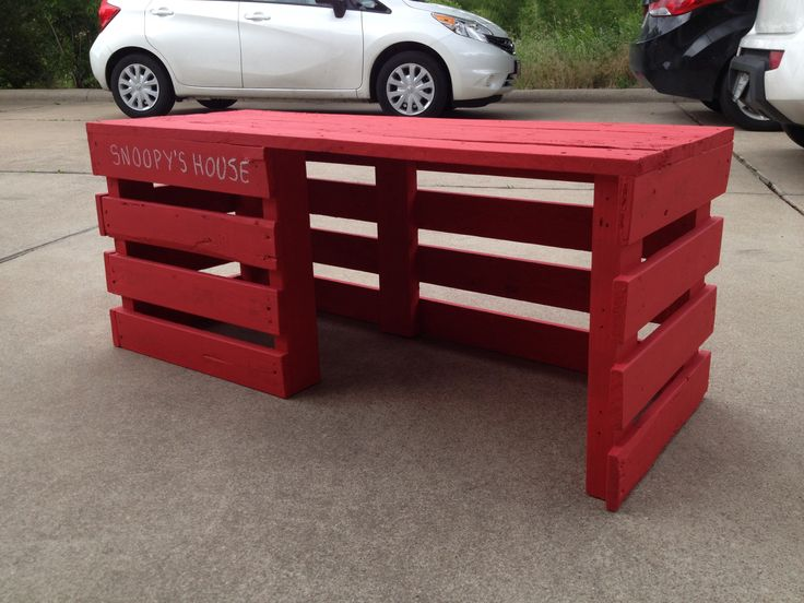 Pallet bench that doubles as a dog house.