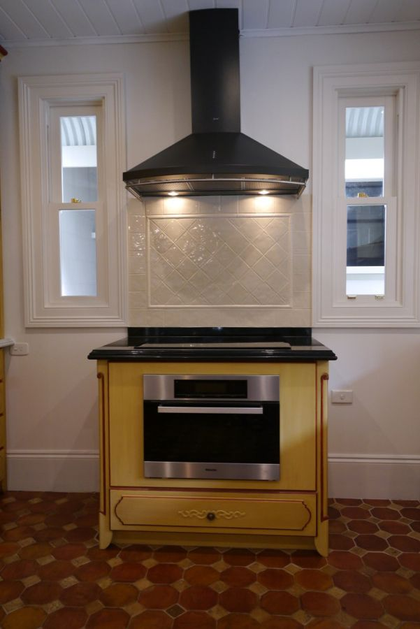 Modern oven with traditional cabinetry - love the steel hood, back lighting and wall tiling - French provincial style in Sydney, Australia