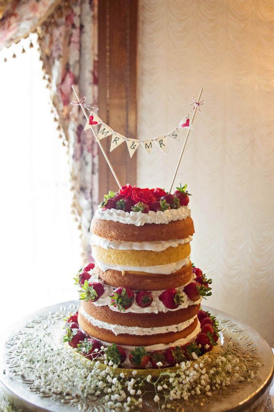"Strawberry shortcake wedding cake with a ""Mr & Mrs"" bunting"