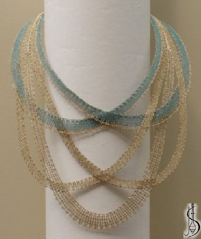 Necklace No. 10505 Blue and beige silk, golden metallic yarn. Price: €…