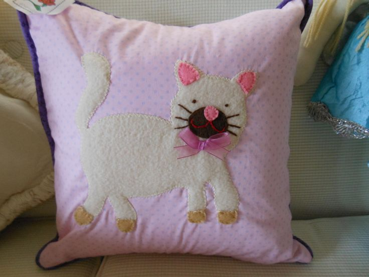 Pretty square pink cushion with purple piping, appliqued kitten in polar fleece.  A lovely tactile cushion for a little girl!