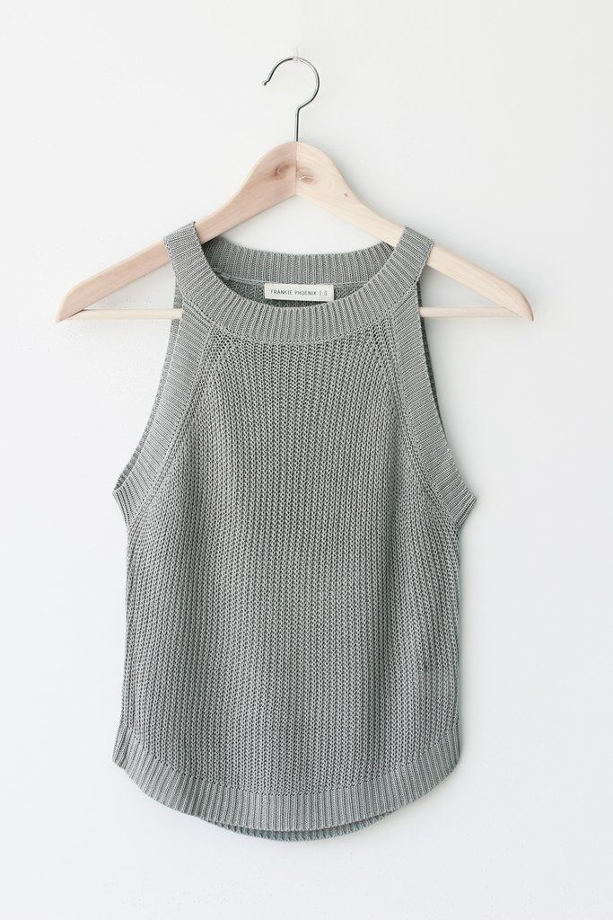 "Details Size Shipping • 90% Cotton 10% Polyester • Knit tank top. • Hand Wash • Line dry • Imported • Measured from small • Length 21"" • Chest 13"" • Waist 13.5"""