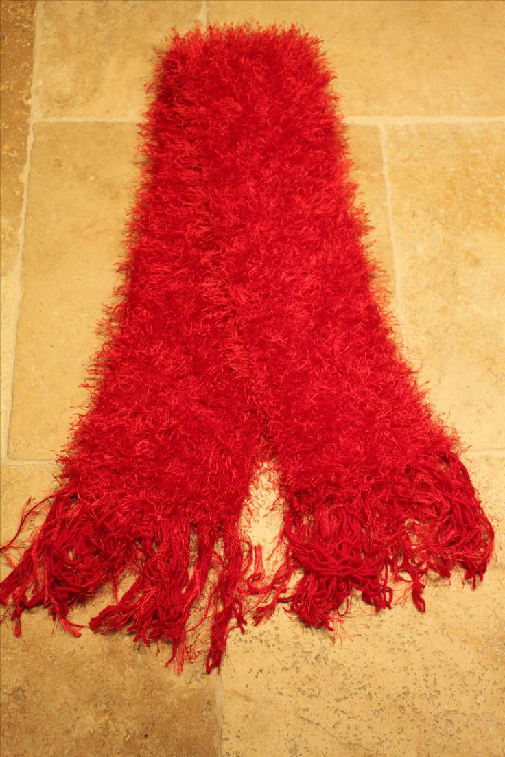 Hand knitted feather and wool scarf