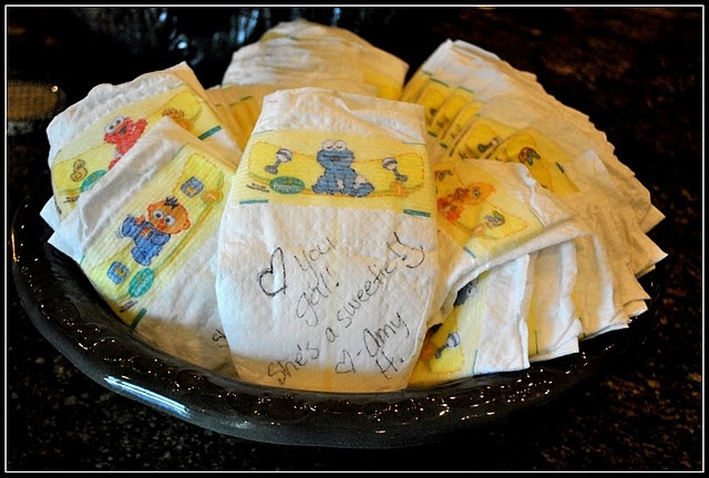 idea for a baby shower....have guests write sweet notes on the diapers and mom can read them when she's up in the middle of the night changing!