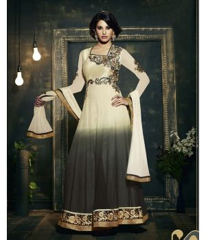 Ombre Georgette Designer Suit $24.98.Revamp your ethnic wardrobe with this matchless Ombre Georgette Designer  Suit. Crafted in fine quality georgette, the designer kameez features an unusual combination of white and green and is embellished with fancy embroidery on the neckline, the waist and the border.