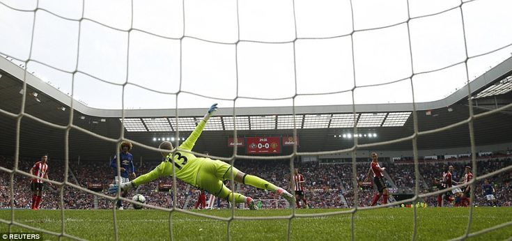 Sunderland goalkeeper Jordan Pickford dives for the ball in vain as Ibrahimovic's shot finds its way into the bottom corner
