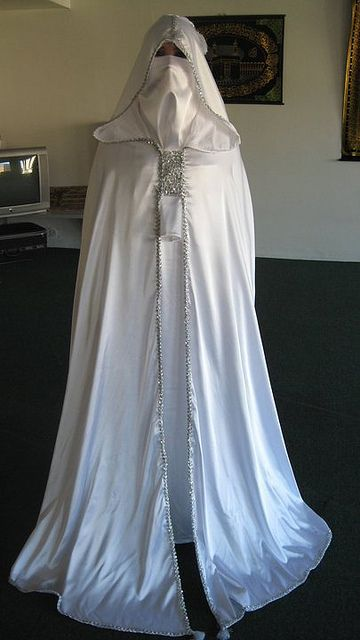 Pretty sure it's a bride posing with the cape and burqa that goes over the actual dress but in the wrong context she looks like a member of the KKK ... looool  found via tumbler