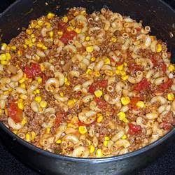 Hillybilly Dinner recipe  ½ cup ·   uncooked elbow macaroni     1 ½ pound ·   ground beef     1 teaspoon ·   garlic powder     1 ·   (8 ounce) can tomato sauce     1 cup ·   stewed, diced tomatoes     1 ·   (15 ounce) can whole kernel corn, drained     1 ·   salt & pepper to taste      ·   chopped, onion