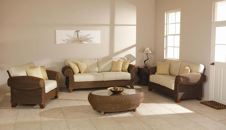 Picture of Living Room Brown Cane Sofas Flower Wall Decoration