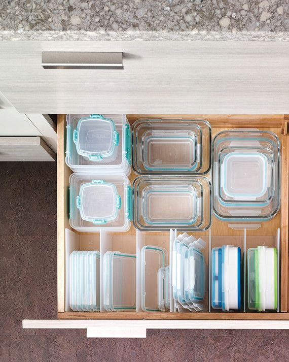 Tame your food storage by using drawer dividers. Now you can easily find the container you need ... and its matching lid!(Pictured: Weston cabinetry and drawer dividers from Martha Stewart Living, available at The Home Depot.)