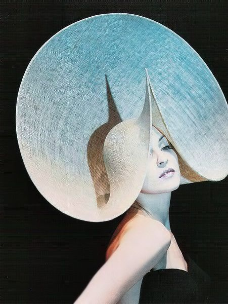 by milliner Philip Treacy.  Brilliant design.  (is that Madonna modeling it?)