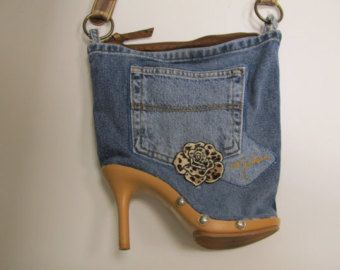 Recycled jeans Shoe Purse. Leopard flower, Brown leather handle. Total of 3 pockets. Plastic heel shoe. Zipper closure.