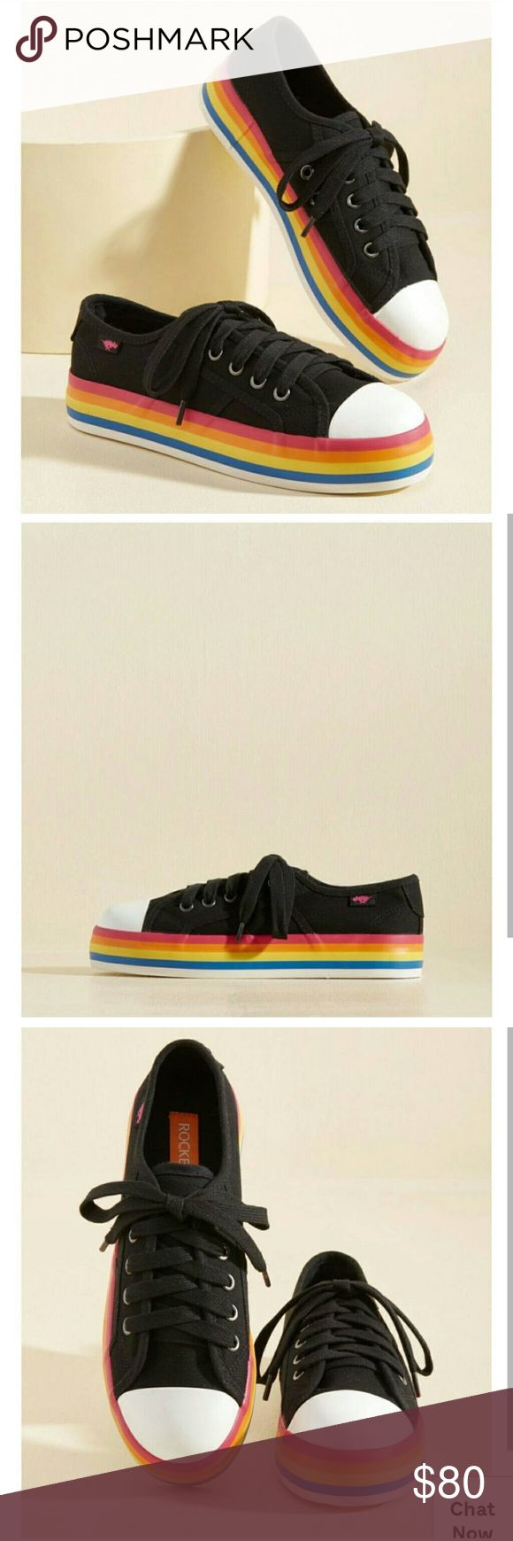 Modcloth Chroma Full Circle Sneaker Your optimistic attitude and aspirational lifestyle have led you to these black canvas sneakers, which infuse your style with positivity. Turns out, repping the rainbow flatform soles and white toe caps of these eye-catching Rocket Dogs offers a heightened sense of elation in return! Funny how that works!  Size 10. Nearly brand new - wore for exactly 20 minutes before I realized they were too large. Best for a 10 or 10.5. Sold out on Modcloth! Modcloth…