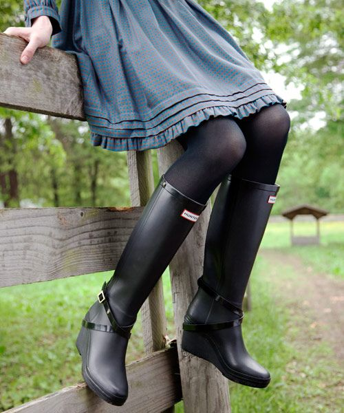 """Rubber boots with wedge heels mean that you don't have to wear flats to be practical.  """"Hunter has a great heritage, and we always refer to our past for inspiration,"""" says Wendy Svarre, CEO, Hunter Boot USA.  Hunter boots, $195; zappos.com. Dress, $119; available in October at llbeansignature.com."""