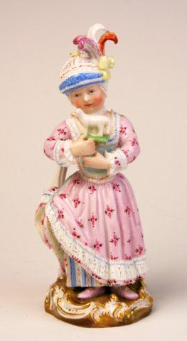 Meissen figure of a girl holding a toy sheep