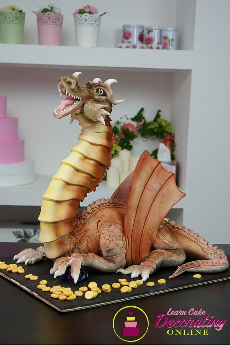 Learn how to make this awesome fire blowing dragon cake!
