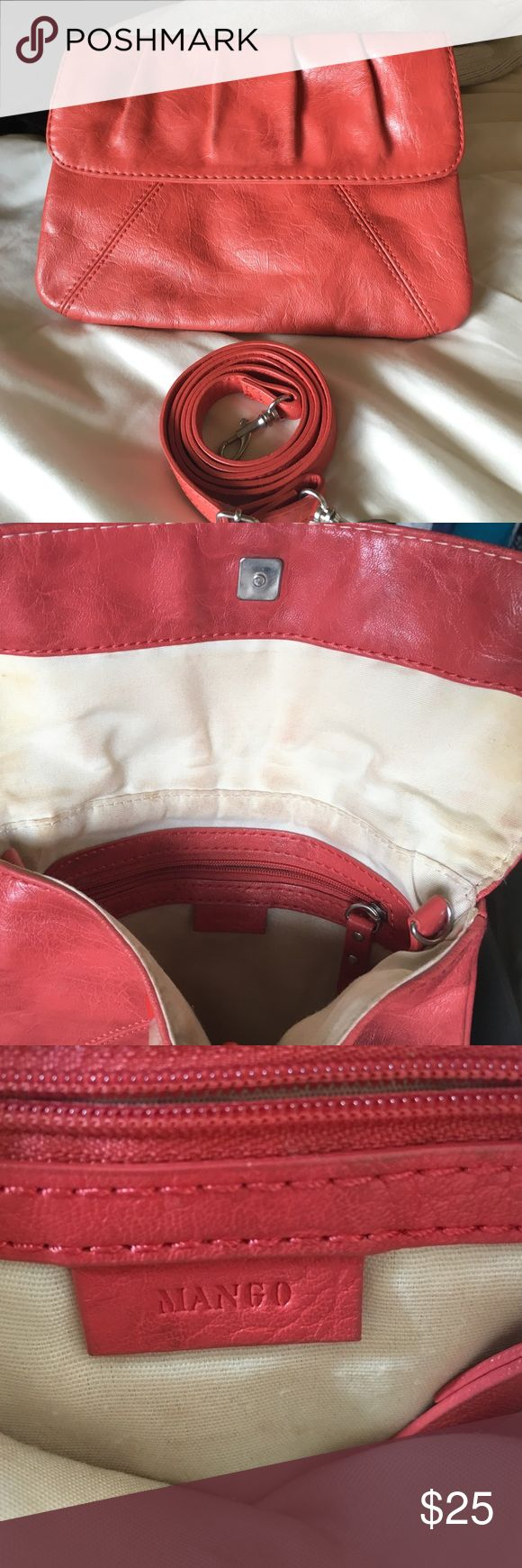 Clutch Adorable summer coral-colored clutch. Some discoloration on the inside but in great condition otherwise. Comes with detachable strap for option to make it a crossbody bag. Last picture shows the size. Mango Bags Clutches & Wristlets