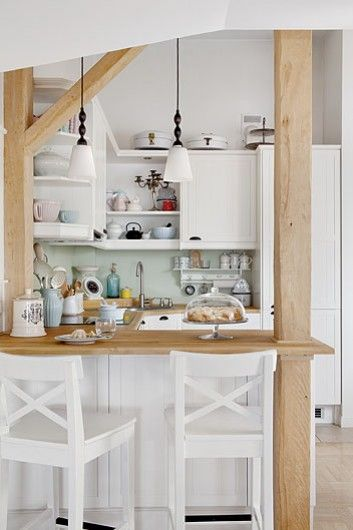 small white kitchen with open shelves and a bar with bar stools, could add a rolling island for extra counter space