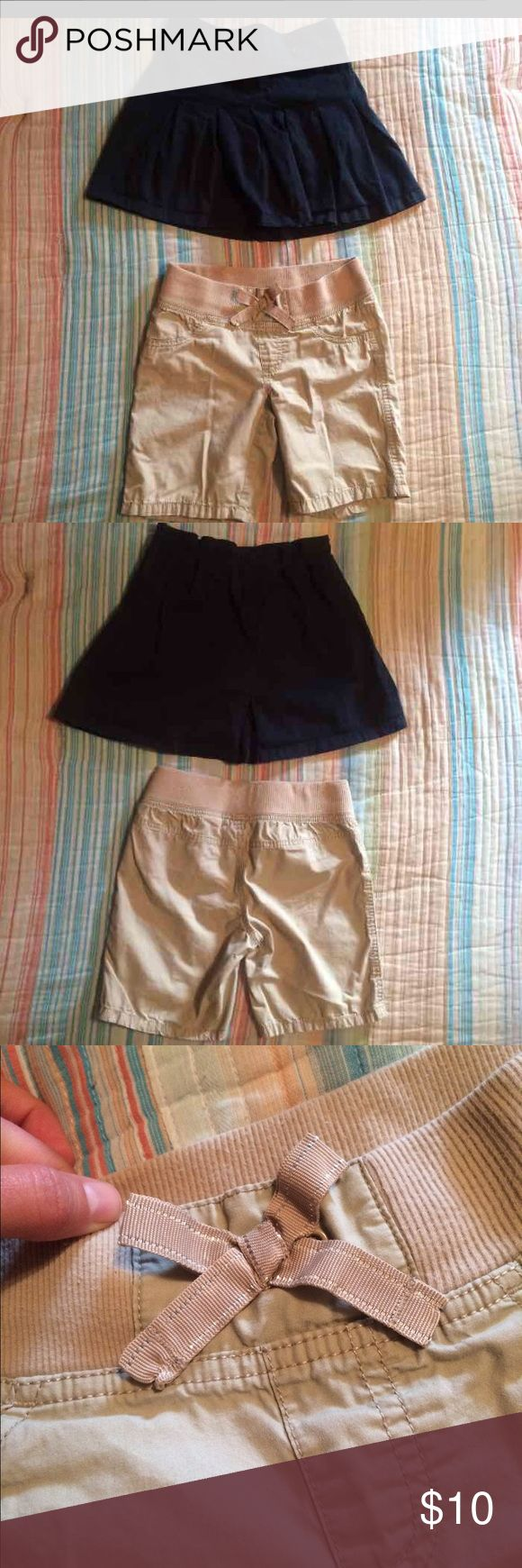 Girl school uniform Bundle- skirt & shorts, 7/8 Girls 2 piece bundle: Navy pleated uniform skirt with attached under-shorts, button waist detail and side zipper. (Size 8) Khaki elastic waist shorts with shimmery stitched bow and non-working pockets on front. (Size 7/8) Bottoms