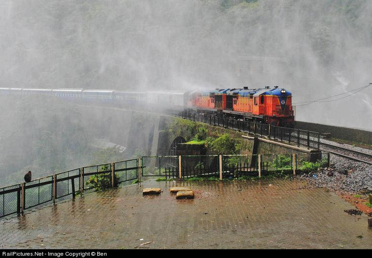 Two WDM-3As with the Amravati Express emerges from the waterfall spray at Doodhsagar!