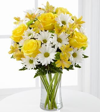 Yellow roses, peruvian lilies, white daisies, and green button poms