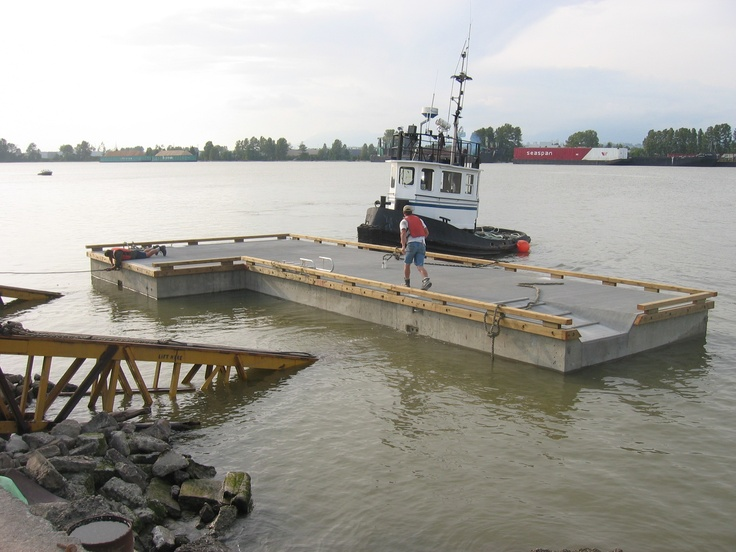 Private one piece concrete float with boat swale