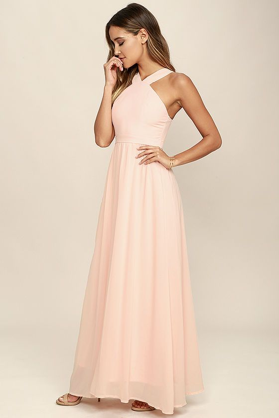 More romantic than a candlelit dinner or a trip to the Eiffel Tower, the Air of Romance Peach Maxi Dress will have you feeling the love! Lightweight Georgette, in a peachy pink hue, falls from a modified halter neckline, into a seamed bodice supported by semi-sheer shoulder straps. A sweeping skirt cascades from a banded waist completing this elegant maxi dress. Hidden zipper with clasp.