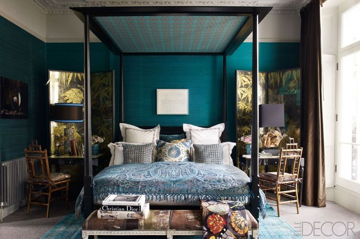 ELLE DECOR | Fashion Editor Kim Hersov's London Home: In the master bedroom, a Louis XVI–style bench upholstered in a Pierre Frey fabric sits at the foot of the custom-made four- poster, the bamboo chairs were found at a Paris flea market, and the desks came from a Madrid jewelry store; the screens are by Nominka D'Albanella, the walls are covered in silk, and the rug is from Lizzo.