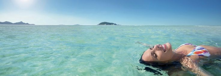 Floating away at Whitehaven Beach in the Whitsundays