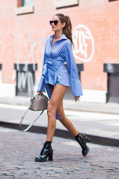 Model Izabel Goulart is seen wearing a CO/MUN shirt Rag Bone jean shorts Louis Vuitton shoes and sunglasses with a Fendi handbag in SoHo on August 19...