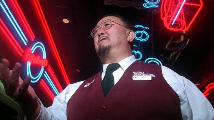 "In this April 2, 1999, file photo, Harry Fujiwara, appears at a movie theater where he works part time as an usher in Knoxville, Tenn. Fujiwara, a former wrestler and manager known as ""Mr. Fuji,"" died at the age of 82. The World Wrestling Entertainment reported he died on Sunday, Aug. 28, 2016."
