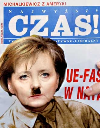 The cover of a March edition of the newspaper Najwyzszy Czas! shows a photo...