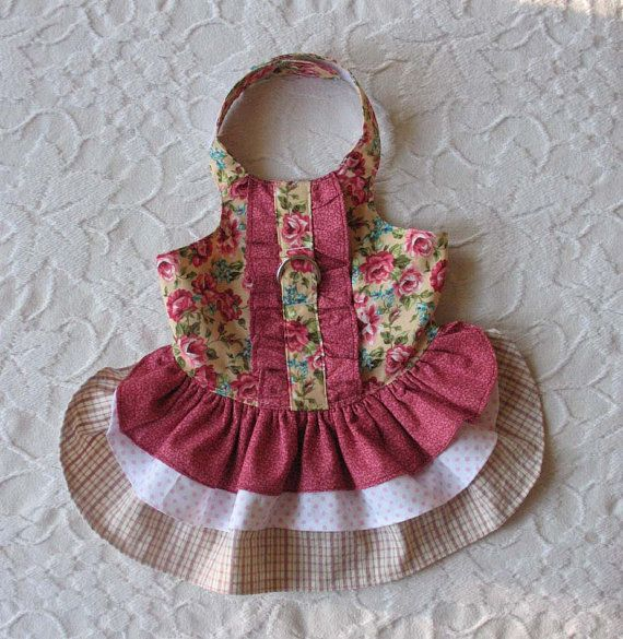 This pretty little dress had a bodice of rose print and a three tier skirt of corresponding prints. It is very feminine and has a d ring if you wish
