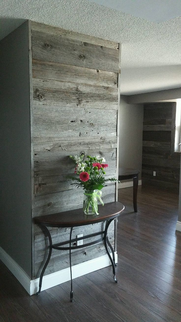 Reclaimed grey barn board feature wall by barnboardstore.com