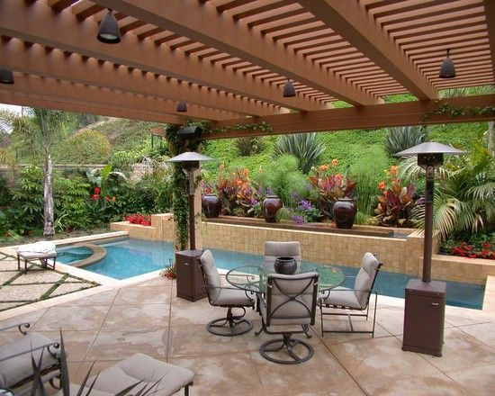Terrace house beside swimming pool with pergola made from for Terrace pergola