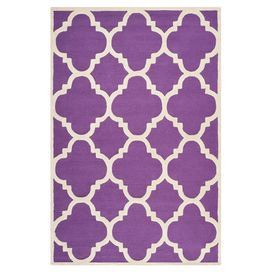 this hand-tufted wool rug, featuring a geometric motif for eye-catching appeal.Purple and ivory