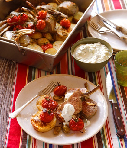 Mediterranean roast ... Bill Granger's rack of lamb with potatoes, tomatoes and olives. Photo by Marina Oliphant. Recipe: http://www.smh.com.au/lifestyle/homestyle/bill-grangers-onepot-wonders-20111012-1lknv.html#