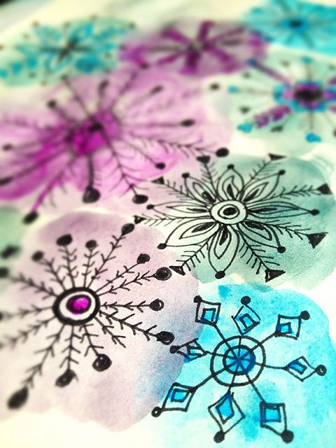 Draw snowflakes with sharpie, paint overtop with watercolours. That looks very doable for the classroom!