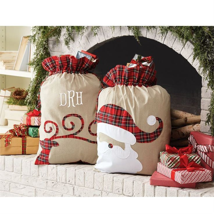 "Canvas Christmas sacks with red tartan faux cuffs and drawstring closures feature Santa appliques with red tartan accents. Perfect for personalization! Size: 31"" x 22"" More"