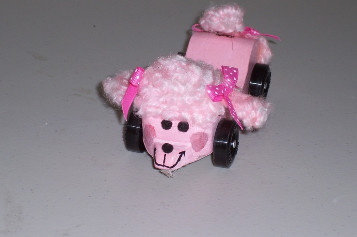 Awana Grand Prix car, The Pink Poodle!  This took first place in design and was thought up by my then 1st grader.  Not the greatest photo of the car.  Oh...and yes, it's a car for a race!  This is what happens when a family has girls first.